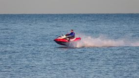DUNGENESS, KENT/UK - DECEMBER 17 ; Man riding a jet ski off Dung. Eness beach in Kent on December 17, 2008. Unidentified man Royalty Free Stock Photo