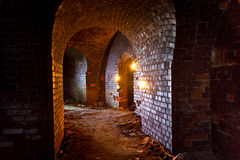 Dungeon under the old german fortress illuminated by lantern and Royalty Free Stock Photography