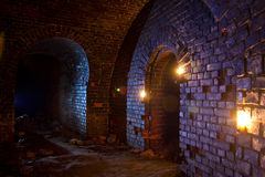 Dungeon under the old german fortress illuminated by lantern and Royalty Free Stock Photo