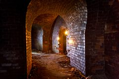 Dungeon under the old german fortress illuminated by lantern and candles.  Stock Images