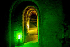 Dungeons with archway and arched entrance with green light Royalty Free Stock Image