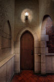 Dungeons in Old Castle. Dungeons with Wooden Door in Old Historic Castle Stock Photo