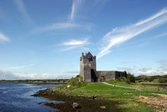 Dunguaire castle with blu sky and clouds Stock Image