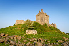 Dunguaire castle on green hill Stock Images