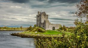 Dunguaire Castle, Kinvara, Ireland. View over the bay and fore-shore with interesting sky Stock Photos