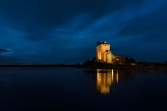Dunguaire Castle at night. Old Irish Dunguaire Castle by the water at night with reflection Stock Photography