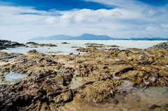 Dungun Beach. View of rocky beach at Dungun, Terengganu royalty free stock photography