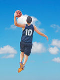 Dunk among the clouds Royalty Free Stock Photos