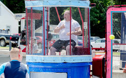 Dunk tank at outdoor summer event Royalty Free Stock Photography