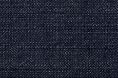 Dunkelblaue Denimjeansbeschaffenheit mit verblassen und erblassen Stockfoto