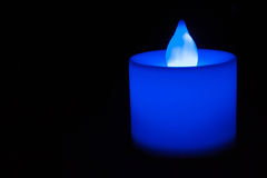 Dunkelblaue elektrische Kerze Stockfotografie