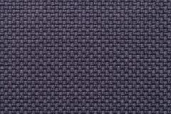 Dunkelblauer Textilhintergrund mit kariertem Muster, Nahaufnahme Struktur des Gewebemakro stockfoto