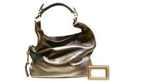 Dunkelbraune Lederhandtasche der Damen Lizenzfreies Stockfoto