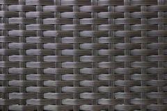 Dunkelbraunes gesponnenes Rattan mit natürlichen Mustern lizenzfreies stockbild