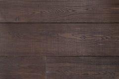 Dunkelbraunes Parkett der Beschaffenheit als abstrakter Beschaffenheitshintergrund, Draufsicht Materielles Holz, Eiche, Ahorn Lizenzfreies Stockbild