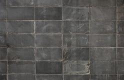 Dunkelgrauer Blockwandhintergrund Stockbild