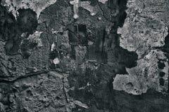Dunkelgrauer Hintergrund des Schmutzes der verwitterten Betonmauer stockfotos
