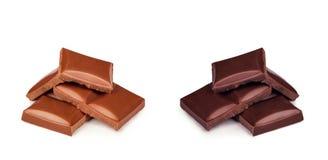 Dunkelheit und Milchschokolade auf einem weißen Hintergrund Stockbilder
