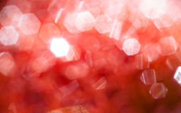 Dunkelroter unscharfer Hintergrund mit dem bokeh sechseckig stockfoto