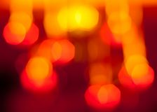 Dunkelrotes und gelbes bokeh Muster Lizenzfreies Stockbild