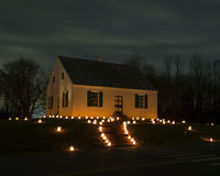 Dunker Church at Antietam Battlefield in Sharpsburg, MD. SHARPSBURG, MD - DEC 3, 2016: Candles light up Dunker Church at Antietam National Battlefield during the Stock Photos
