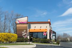 Dunkin` Donuts sign. Dunkin` Donuts is an American global doughnut company and coffeehouse chain. royalty free stock photos