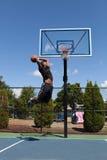 Dunking баскетболиста Стоковые Изображения RF