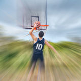 Dunking in a blurred court Royalty Free Stock Images