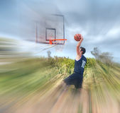 Dunking in a blurred playground Stock Photos
