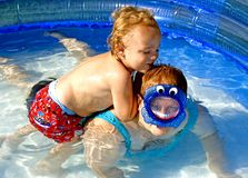 Dunking Mom. Young boy trying to dunk mother in pool Stock Images