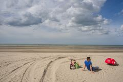 Peaceful beach of Dunkirk, in France. Place of the Dynamo operation in 1940. DUNKIRK, FRANCE – june 1, 2015 : It was on this peaceful beach that the royalty free stock photography