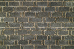 Dunkle Backsteinmauer im Porzellan Stockfoto