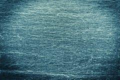 Dunkle Farbe des Steinhintergrundes mit einer ausdrucksvollen Beschaffenheit Lizenzfreies Stockbild