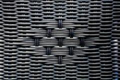 Dunkle Farbkünstliches Rattanmuster Hintergrund der Korbstrukturnahaufnahme lizenzfreies stockbild