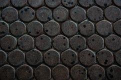 Dunkler ditry Straßenziegelsteinwurmblock-Wurmhintergrund Stockfoto