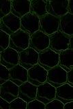 Dunkler Hintergrund mit Bienenwabenmuster Stockfoto