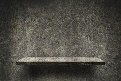 Dunkles Felsenkiesel-Beschaffenheitsregal für Produktanzeige stock abbildung