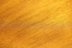 Dunkles Gold Es ist Tapetengoldfarbe Abstrakter glatter bunter Kranke stockfoto