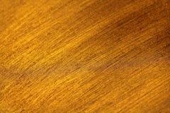 Dunkles Gold Es ist Tapetengoldfarbe Abstrakter glatter bunter Kranke stockbilder