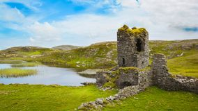 Dunlough Castle, ruins in Three Castles Head, in the Mizen Peninsula. Dunlough Castle, standing atop the cliffs at the northern tip of the Mizen Peninsula, looks Stock Photos