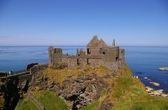 Dunluce Castle. Ancient castle ruins on cliff top on Northern Ireland Royalty Free Stock Photography