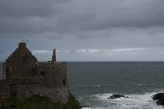 Dunluce Castle, Antrim, Northern Ireland. During cloudy sky royalty free stock photo