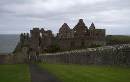 Dunluce Castle, Antrim, Northern Ireland. During cloudy sky stock photography