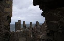 Dunluce Castle, Antrim, Northern Ireland. During cloudy sky stock image