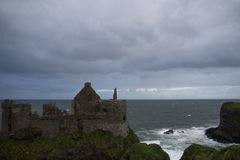 Dunluce Castle, Antrim, Northern Ireland. During cloudy sky royalty free stock image