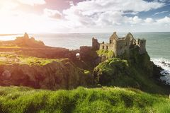 Dunluce Castle, Antrim, Northern Ireland during sunny day. With semi cloudy sky stock photos