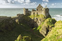 Dunluce Castle, Antrim, Northern Ireland during sunny day. With semi cloudy sky royalty free stock image