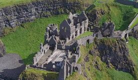 Dunluce Castle Co Antrim Northern Ireland blue sea background for editor's text. Copy writing stock image