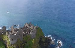 Dunluce Castle Co Antrim Northern Ireland blue sea background for editor's text. Copy writing royalty free stock images