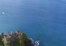 Dunluce Castle Co Antrim Northern Ireland blue sea background for editor's text. Copy writing stock photography